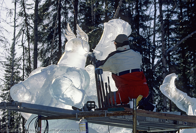Kevin Roscoe uses a grinder to shape the award winning sculpture The Joust, during the World Ice Art Championships held each march in Fairbanks.