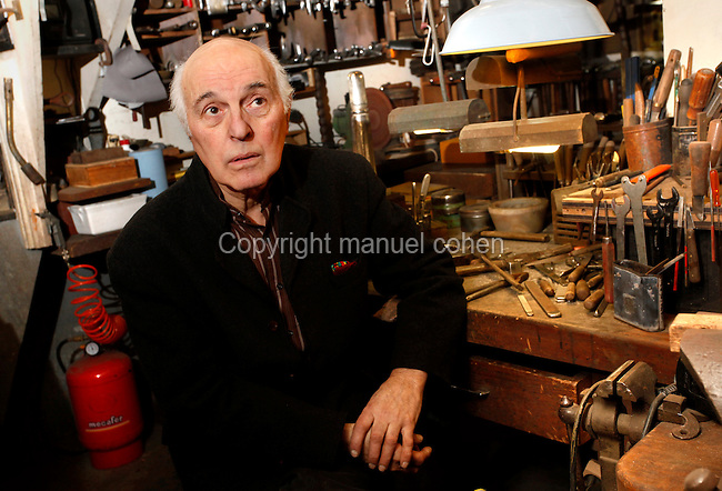 Dans son atelier parisien, le 12 janvier 2011, l'orfèvre Goudji révèle et explique les outils les plus familiers de son art. Nait en Géorgie en 1941, Goudji vit à Paris depuis 1974 sur intervention personnelle du Président de la République Georges Pompidou, où il produit sa création d'orfèvre contemporain. Ses oeuvres sont innombrables tant en Art d'Eglise, Epées, Bijoux que sculptures diverses. In his Parisian studio, on 12th January 2011, goldsmith Goudji demonstrates and explains the  most familiar tools of his trade. Born in Georgia in 1941, Goudji has lived in Paris since 1974, due to the personal intervention of  President Georges Pompidou.  Here he produces his numerous contemporary works of goldsmithery in  such widely differing fields as Church Art, swords, jewellery and sculpture. Picture by Manuel Cohen