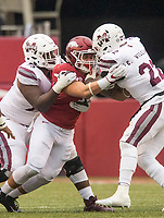 Hawgs Illustrated/BEN GOFF <br /> Grant Morgan (31), Arkansas linebacker, stops Aeris Williams (22), Mississippi State running back, as Darryl Williams (73), Mississippi State offensive lineman, tries to block in the fourth quarter Saturday, Nov. 18, 2017, at Reynolds Razorback Stadium in Fayetteville.