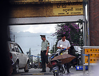 A car is searched by border guards at the Chinese - Burmese border crossing in Ruili, China. Chinese-Burmese gangs smuggle drugs across the border from Muse, in Burma and smuggle them out of Ruili using drug mules.  Synthetic drugs are manufactured in labs in Burma and these dats form the bulk of drugs smuggled....PHOTO BY SINOPIX
