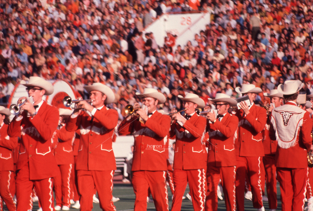 In this vintage 1970 photo the University of Texas Longhorn Band, also known as the Show band of the Southwest plays to the home crowd during a Southwest Conference football game in Memorial Stadium, Austin, Texas.