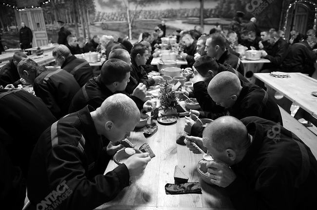 Prisoners have lunch with New Year decorations hanging from the ceiling and small christmas trees on the tables. Prison colony #7 outside of Novgorod in the Novgorod region south of St. Petersburg, Russia, December 15, 2008.