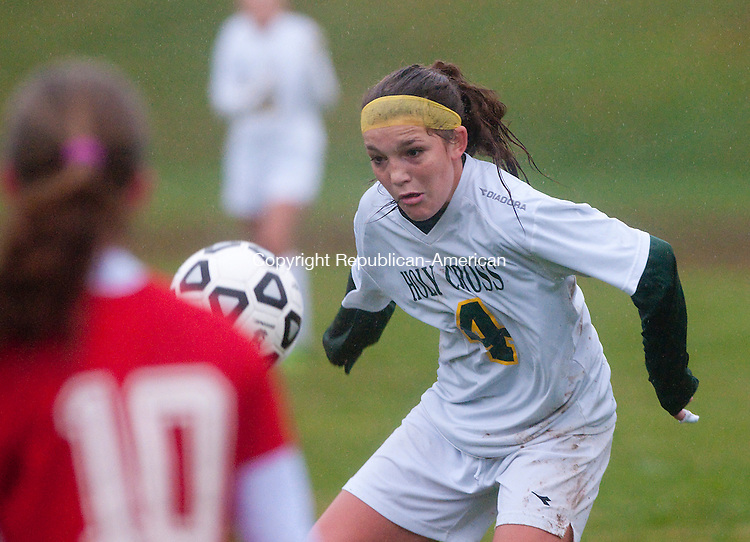 WATERBURY, CT-110614JS04- Holy Cross' Julia Sheetz (4) gets control of the ball during their tournament game against St. Bernard Thursday at Holy Cross High School in Waterbury.<br />   Jim Shannon Republican-American