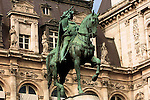 Statue of man on horse with sword
