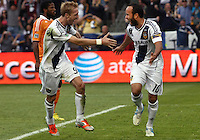 CARSON, CA - DECEMBER 01, 2012:   Christian Wilhelmsson (9) and  Landon Donovan (10) of the Los Angeles Galaxy after  Landon Donovan (10) had scored against the Houston Dynamo during the 2012 MLS Cup at the Home Depot Center, in Carson, California on December 01, 2012. The Galaxy won 3-1.