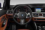 Car pictures of steering wheel view of a 2020 BMW 3-Series M-Sport 5 Door Wagon Steering Wheel