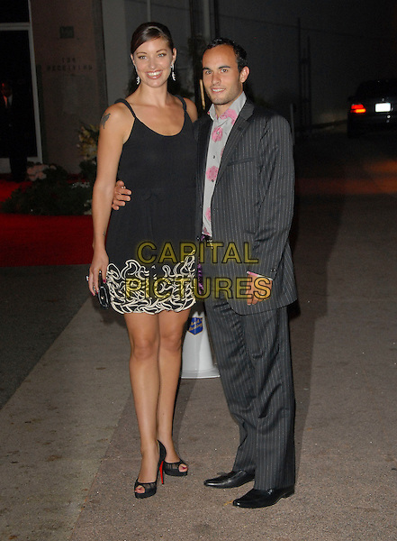 LANDON DONOVAN & GIRLFRIEND.at The Beckham's Welcome to America Party held at MOCA Geffen in Los Angeles, California, USA, .July 22, 2007..LA full length black dress               .CAP/DVS.©Debbie VanStory/Capital Pictures