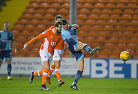 Luke O'Nien of Wycombe Wanderers shoots under pressure from Mark Yeates of Blackpool during the The Checkatrade Trophy match between Blackpool and Wycombe Wanderers at Bloomfield Road, Blackpool, England on 10 January 2017. Photo by Andy Rowland / PRiME Media Images.
