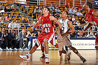 28 January 2012:  FIU guard Cameron Bell (10) and WKU guard-forward Vinny Zollo (41) battles for position on a rebound in the second half as the Western Kentucky University Hilltoppers defeated the FIU Golden Panthers, 61-51, at the U.S. Century Bank Arena in Miami, Florida.