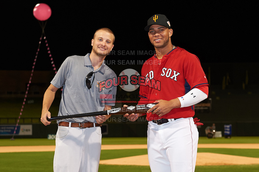 Surprise Saguaros Yoan Moncada (10), of the Boston Red Sox organization, is presented with the American League third place trophy bat from Zinger by Josh Michalsen during the Bowman Hitting Challenge on October 8, 2016 at the Salt River Fields at Talking Stick in Scottsdale, Arizona.  (Mike Janes/Four Seam Images)