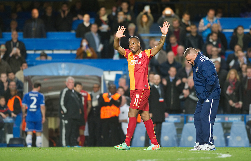 Galatasaray's Didier Drogba salutes the fans at the end of the game<br /> <br /> Photo by Ashley Western/CameraSport<br /> <br /> Football - UEFA Champions League First Knockout Round 2nd Leg - Chelsea v Galatasaray - Tuesday 18th March 2014 - Stamford Bridge - London<br />  <br /> &copy; CameraSport - 43 Linden Ave. Countesthorpe. Leicester. England. LE8 5PG - Tel: +44 (0) 116 277 4147 - admin@camerasport.com - www.camerasport.com