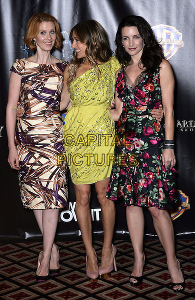 CYNTHIA NIXON, SARAH JESSICA PARKER & KRISTIN DAVIS.Warner Brothers ShoWest Presentation at the Paris Resort Hotel and Casino, Las Vegas, Nevada, USA..March 18th, 2010.full length purple cream brown pattern print green one shoulder pink black floral print dress  SATC Sex and the city  sjp profile  silver beads beaded .CAP/ADM/MJT.© MJT/AdMedia/Capital Pictures.