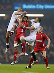 Taulupe Faletau of Wales wins the ball from Jonathan Joseph and  Luther Burrell of England- RBS 6Nations 2015 - Wales  vs England - Millennium Stadium - Cardiff - Wales - 6th February 2015 - Picture Simon Bellis/Sportimage