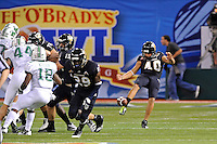 20 December 2011:  FIU punter Josh Brisk (40) punts in the first quarter as the Marshall University Thundering Herd defeated the FIU Golden Panthers, 20-10, to win the Beef 'O'Brady's St. Petersburg Bowl at Tropicana Field in St. Petersburg, Florida.