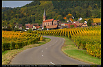 A powerful S-shaped curve leads the viewer into the composition and this church. Autumn along the Route du Vin in the Alsace, France.