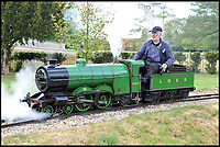 BNPS.co.uk (01202 558833)<br /> Pic:  BraybrookCollection/BNPS<br /> <br /> One of the longest serving drivers on one of the model trains.<br /> <br /> A late aristocrat's prized collection of model trains has sold for £244,000.<br /> <br /> Lord Braybrooke set up a miniature garden railway 55 years ago in the grounds of his stately home at Audley End House in Saffron Walden, Essex.<br /> <br /> He died in 2017 and his family parted with nine of his locomotives to raise funds to improve the railway's facilities so it can keep running for future generations.