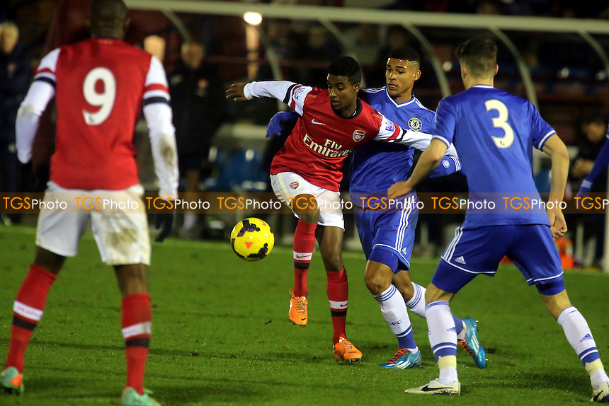 Gedion Zelalem of Arsenal tries to shield the ball from Chelsea's Ruben Loftus Cheek - Chelsea Under-21 vs Arsenal Under-21 - Barclays Under-21 Premier League Cup Football at Aldershot FC - 27/01/14 - MANDATORY CREDIT: Paul Dennis/TGSPHOTO - Self billing applies where appropriate - 0845 094 6026 - contact@tgsphoto.co.uk - NO UNPAID USE
