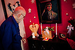 "Will Langdon looks at the box holding his wife Naomi's ashes in his Alabama Avenue home in Sun City, Arizona January 9, 2010. Will has lived in Sun City since it opened in 1960. This year is Sun City's 50th anniversary..When he first came to Sun City with his wife the area was surrounded by cotton fields. His house was one of the first built in Sun City. Before he had a wall in his backyard, he and his neighbors would gather on Sundays. ""We would gather and bring all the tables and food out. It was ver nice, but times change and people die,"" he said..His home is filled with John Wayne and other western memorabilia. ""John Wayne is my heo. He exemplifies what every man should do and be,"" he said..Will's wife Naomi has since passed away and he is recovering from prostate cancer. He has outlived his friends, as well. ""I'm what you call the last of the Mohicans and I'm holding on."""