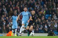Ilkay Gundogan of Manchester City moves away from Tomas Rogic of Celtic during the UEFA Champions League GROUP match between Manchester City and Celtic at the Etihad Stadium, Manchester, England on 6 December 2016. Photo by Andy Rowland.