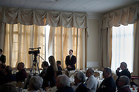 Members of the Gingrich security team stand at the edge of the event as Newt Gingrich speaks to the Nashua Rotary Club at the Nashua Country Club in Nashua, New Hampshire, on Jan. 9, 2012.  Gingrich is seeking the 2012 Republican presidential nomination.
