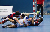 02 NOV 2011 - LONDON, GBR -  Britain's Robin Garnham (right - blue and red) holds onto the ball as his team mate John Pearce (left - blue and red) and Israel's Chen Pomeranz (centre - white) fall beside him  (PHOTO (C) NIGEL FARROW)
