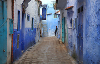 Narrow street in the medina or old town of Chefchaouen in the Rif mountains of North West Morocco. Chefchaouen was founded in 1471 by Moulay Ali Ben Moussa Ben Rashid El Alami to house the muslims expelled from Andalusia. It is famous for its blue painted houses, originated by the Jewish community, and is listed by UNESCO under the Intangible Cultural Heritage of Humanity. Picture by Manuel Cohen