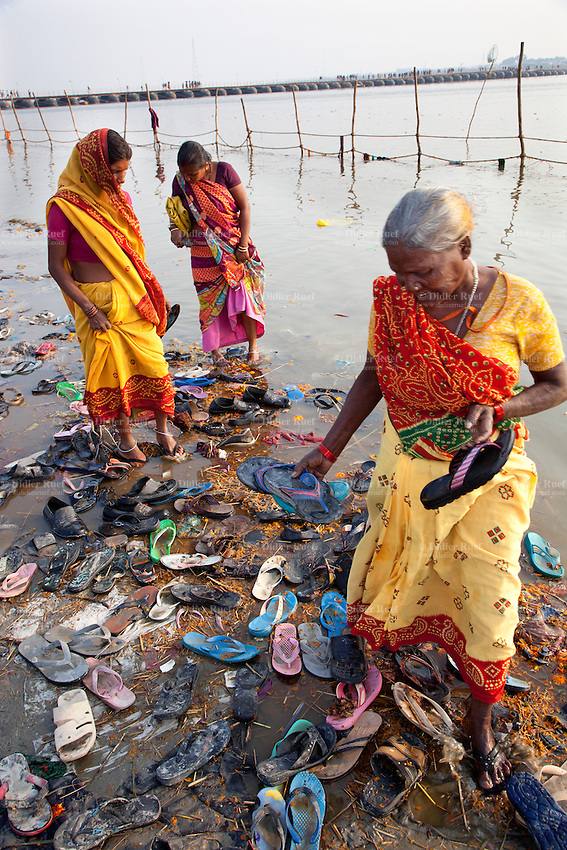 India. Uttar Pradesh state. Allahabad. Maha Kumbh Mela. Indian Three women are collecting colourful flip flop shoes lost in the water by Hindu devotees. The Kumbh Mela, believed to be the largest religious gathering is held every 12 years on the banks of the 'Sangam'- the confluence of the holy rivers Ganga, Yamuna and the mythical Saraswati. In 2013, it is estimated that nearly 80 million devotees took a bath in the water of the holy river Ganges. The Maha (great) Kumbh Mela, which comes after 12 Purna Kumbh Mela, or 144 years, is always held at Allahabad. Uttar Pradesh (abbreviated U.P.) is a state located in northern India. 11.02.13 © 2013 Didier Ruef