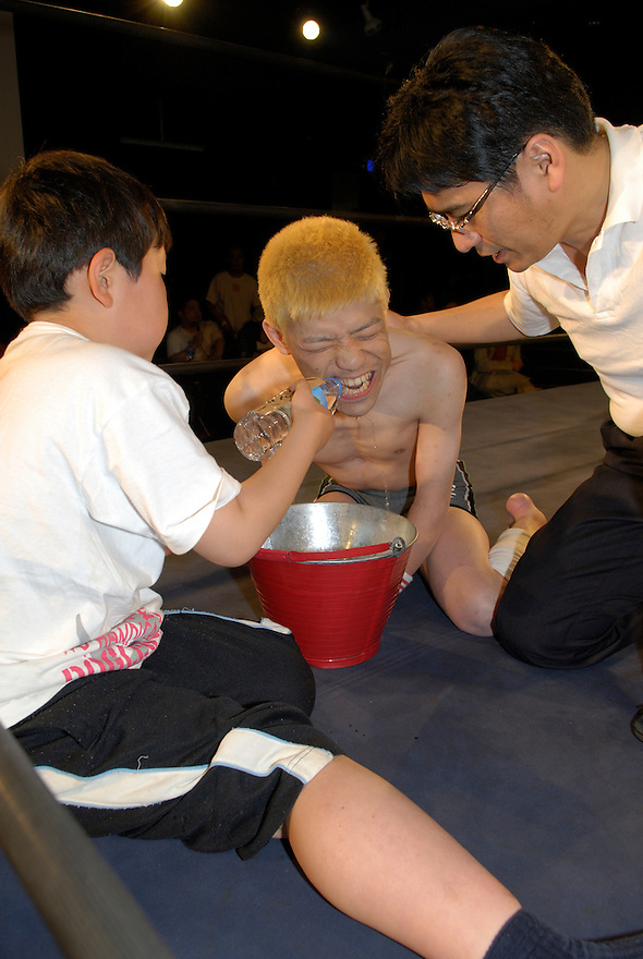 "Yasuhiro Kayahara, AKA ""No Sympathy"" has a drink during the break."