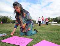 NWA Democrat-Gazette/ANDY SHUPE<br /> Diana Rivers of Madison County makes signs Wednesday, Sept. 30, 2015, in support of Planned Parenthood during a rally along Crossover Road in Fayetteville. The rally was organized by members of the Omni Center for Peace, Justice and Ecology's EcoFeminist Study and Action Group as a part of a national rally in support of Planned Parenthood's Pink Out day, which was Tuesday.