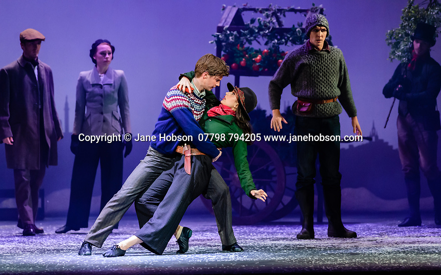 Edinburgh, UK. 06.12.2019. Scottish Ballet presents the world premiere of The Snow Queen, at the Festival Theatre. The work is choreographed by Christopher Hampson, to the music of Rimsky-Korsakov, with set and costume design by Lez Brotherston, and lighting design by Paul Pyant.  The cast is: Constance Devernay (Snow Queen), Bethany Kingsley-Garner (Gerda), Andrew Peasgood (Kai), Kayla-Maree Tarantolo (Lexi). The picture shows: Andrew Peasgood (Kai), Kayla-Maree Tarantolo (Lexi). Photograph © Jane Hobson.