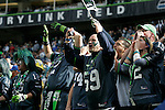 Seattle Seahawks fans cheer against the Arizona Cardinals at CenturyLink Field in Seattle, Washington September 25, 2011.  The Seahawks beat the Cardinals 13-10.  ©2011 Jim Bryant Photo. All Rights Reserved.