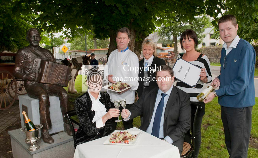 The Killarney Chamber of Tourism & Commerce has announced today that visitors in the town can expect to enjoy a saving of 10 million per year in accommodation & dining, under the new 9% VAT rate which will come into effect on July 1st. Local business organisations have called on all those impacted by the impending VAT reduction to embrace the lower tax rate and give back to consumers in the Killarney area. Supported by the Kerry branch of the Irish Hotels Federation, The Restaurant Association and the local Vintners Federation, the Killarney Chamber of Tourism & Commerce is welcoming the Governments reduction on the VAT rate to 9%, confident that it will help to boost tourism in the town and throughout the country as long as it is supported by the service industry as a whole.  Picture shows Hotelier Claire Scally on left with  with Tom Randles, President, Killarney Chamber of Tourism and at back, chef Geert Maes, Restauranteur Antoinette Casey, waitress Maria Warren, publican Paidi O'Callaghan and jarvey Ger Cronin showing how industries in Kilalrney are welcoming the reduced vat changes..Picture by Don MacMonagle...photo from Killarney chamber..