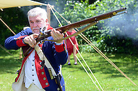 Kent Snell of the Second Pennsylvania Regiment shows how to fire a musket during the Hatboro Tricentennial celebration at Pennypack Elementary School Saturday June 13, 2015 in Hatboro, Pennsylvania.  (Photo by William Thomas Cain/Cain Images)