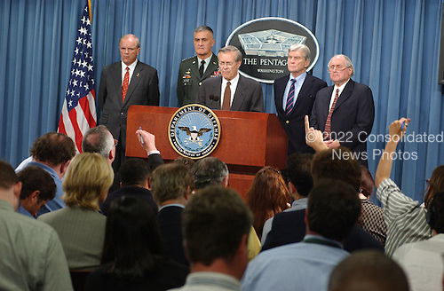 """The Pentagon is functioning"" was the message Defense Secretary Donald Rumsfeld stressed during a press conference in the Pentagon briefing room barely eight hours after terrorists crashed a hijacked commercial jetliner into the national military headquarters on Tuesday, September 11, 2001.  Pictured left to right: Secretary of the Army Tom White, Chairman of the Joint Chiefs of Staff Army General Henry Shelton, U.S. Secretary of Defense Donald Rumsfeld, and U.S. Senator John Warner (Republican of Virginia) and U.S. Senator Carl Levin (Democrat of Michigan). .Mandatory Credit: Bob Houlihan - DoD via CNP."