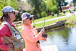 River Buddy Carol Birchill assists Laura Diko during the Casting for Recovery fishing clinic at Bently Ranch in Gardnerville, Nev. May 4, 2018.<br /> Photo by Candice Vivien/Nevada Momentum