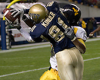 University of Pittsburgh Wide Receiver Derek Kinder looks to make a great catch against West Virginia but was unable to hold on as the Pitt Panthers were defeated by the WVU Mountaineers 45-27 on November 16, 2006 at Heinz Field, Pittsburgh, Pennsylvania.
