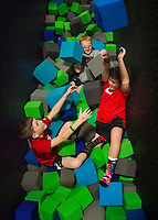 NWA Democrat-Gazette/BEN GOFF @NWABENGOFF<br /> Blake Rogers (from left), Peyton Bailey and Trevor Harvey, all 10 and from Farmington, play in one of the foam pits Thursday, Jan. 4, 2018, at High Rise Extreme Air Sports in Rogers.