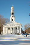 1st Congregational Church, 26 Meeting House Lane, Madison, CT 06443. Man shoveling snow by hand.