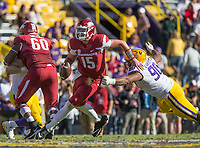 NWA Democrat-Gazette/BEN GOFF @NWABENGOFF<br /> Cole Kelley (15), Arkansas quarterback, evades Rashard Lawrence, LSU defensive end, in the fourth quarter Saturday, Nov. 11, 2017 at Tiger Stadium in Baton Rouge, La.