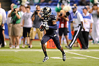 20 December 2011:  FIU defensive back Richard Leonard (3) returns a kick in the third quarter as the Marshall University Thundering Herd defeated the FIU Golden Panthers, 20-10, to win the Beef 'O'Brady's St. Petersburg Bowl at Tropicana Field in St. Petersburg, Florida.