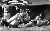 "Oakland A's pitcher John ""Blue Moon"" Odom is tagged out at home by Cincinnati Reds catcher Johnny Bench.<br />