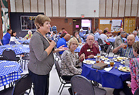 STAFF PHOTO BEN GOFF  @NWABenGoff -- 09/28/14 Debbie Rambo, director of Samaritan Community Center, speaks during a meal at First United Methodist Church served by volunteers with Samaritan Community Center as a way for church members to learn about the center and it's work on Sunday September 28, 2014. The meal is part of a series of events examining the hunger problem in Northwest Arkansas.
