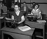 Pittsburgh PA: Young women working hard in Duquesne University's typing class - 1932