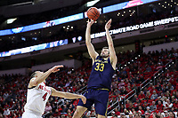 RALEIGH, NC - JANUARY 9: John Mooney #33 of the University of Notre Dame takes a fadeaway jump shot during a game between Notre Dame and NC State at PNC Arena on January 9, 2020 in Raleigh, North Carolina.