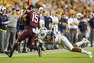 Landover, MD - September 3, 2017: West Virginia Mountaineers cornerback Hakeem Bailey (24) makes  a tackle during game between Virginia Tech and WVA at  FedEx Field in Landover, MD.  (Photo by Elliott Brown/Media Images International)