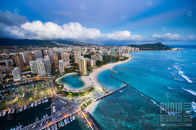 An aerial view at sunset of Ala Wai Harbor and Waikiki, with Diamond Head Crater in the distance, Honolulu, O'ahu.