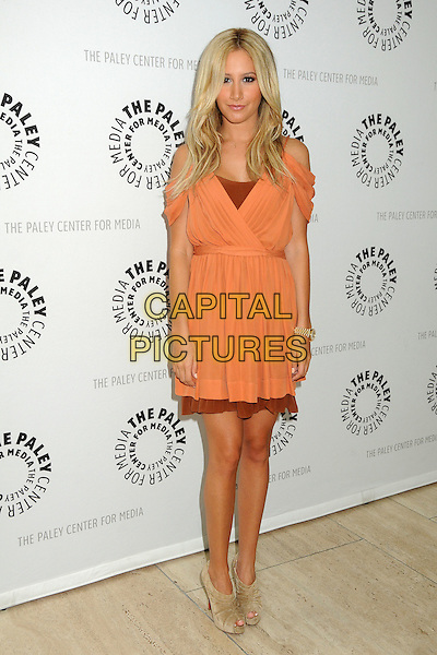 "Ashley Tisdale.PaleyFest Family 2011 Presents Disney's ""Phineas & Ferb"" held at The Paley Center for Media, Beverly Hills, California, USA, 13th August 2011 .full length dress  layered  beige ankle boots shoes shooboots peep toe booties orange  cur out off the shoulders christian louboutin .CAP/ADM/BP.©Byron Purvis/AdMedia/Capital Pictures."