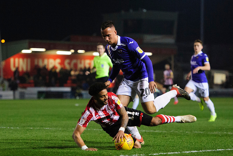 Lincoln City's Bruno Andrade vies for possession with Exeter City's Kane Wilson, but his appeal for a penalty was turned down<br /> <br /> Photographer Chris Vaughan/CameraSport<br /> <br /> The EFL Sky Bet League Two - Lincoln City v Exeter City - Tuesday 26th February 2019 - Sincil Bank - Lincoln<br /> <br /> World Copyright © 2019 CameraSport. All rights reserved. 43 Linden Ave. Countesthorpe. Leicester. England. LE8 5PG - Tel: +44 (0) 116 277 4147 - admin@camerasport.com - www.camerasport.com