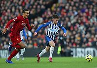 30th November 2019; Anfield, Liverpool, Merseyside, England; English Premier League Football, Liverpool versus Brighton and Hove Albion; Aaron Connolly of Brighton and Hove Albion is chased by Virgil van Dijk of Liverpool as he races through on goal - Strictly Editorial Use Only. No use with unauthorized audio, video, data, fixture lists, club/league logos or 'live' services. Online in-match use limited to 120 images, no video emulation. No use in betting, games or single club/league/player publications