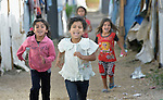 Children play in a settlement of Syrian refugees in Minyara, a village in the Akkar district of northern Lebanon. Lebanon hosts some 1.5 million refugees from Syria, yet allows no large camps to be established. So refugees have moved into poor neighborhoods or established small informal settlements in border areas. International Orthodox Christian Charities, a member of the ACT Alliance, provides support for families in this settlement.